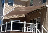 Residential adjustable pitch retractable deck awning 2.