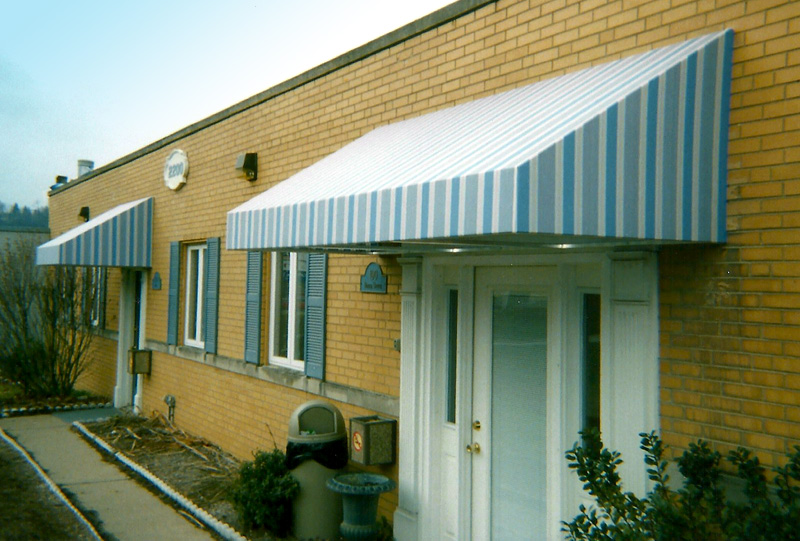 Greentree Entryway Awnings - Commercial welded frame shed style awnings 15a.